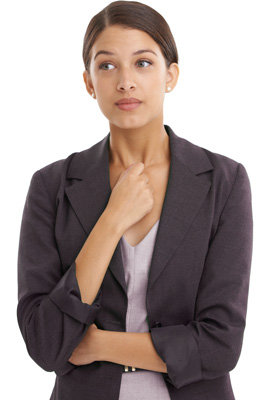 Anxious woman with arms crossed in business suit